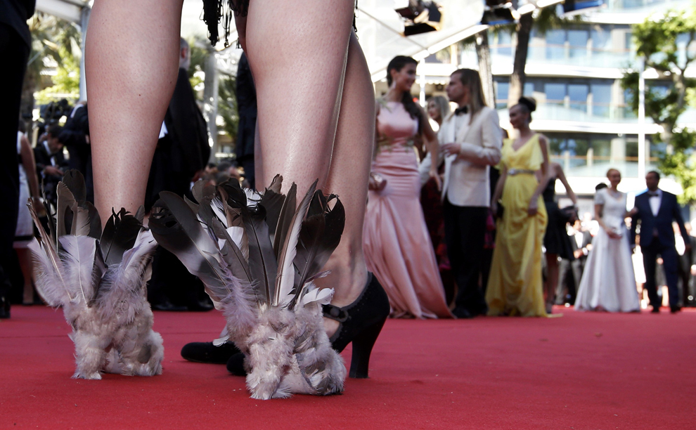 "The shoes of a guest are pictured as she poses on the red carpet during arrivals for the screening of the film ""Youth"" in competition at the 68th Cannes Film Festival in Cannes, southern France, May 20, 2015.              REUTERS/Eric Gaillard"