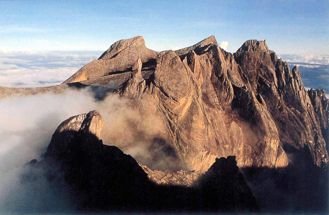 KOTA KINABALU, MALAYSIA:  This undated photo shows Mount Kinabalu, South East Asia's highest peak, in East Malaysia's state of Sabah. A Malaysian rescue team has found signs that 17-year-old British girl Ellie James who got lost on Mount Kinabalu for six days may still be alive.  Ellie, on holiday from Cornwall, England became separated from her family August 16 2001 while descending the 4,101 metre (13,454 feet) Mount Kinabalu in bad weather. She wandered off with her 15-year-old brother Henry, but he was found six hours later by rescuers. A special 20-man disaster relief team from Kuala Lumpur arrived 21 August 2001 and joined some 70 rescuers, including police, troops and volunteers, to comb the foggy jungle as they continue their search.    AFP PHOTO (Photo credit should read AFP/Getty Images)